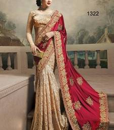 Buy red embroidered SILK GEORGETT  and  RASSAL NET saree with blouse net-saree online