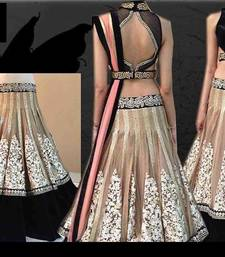 Buy creame embroidered net unstitched bollywood-lehengas bollywood-lehenga online
