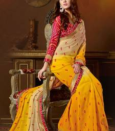 Buy chiku  and  yellow worked padding georgette saree with blouse georgette-saree online