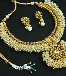Buy Designer Beautiful Kundan Pearl Copper Necklace set necklace-set online