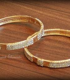 Buy Bollywood style designer zircon stud golden plated bangles(set of 2) gifts-for-her online