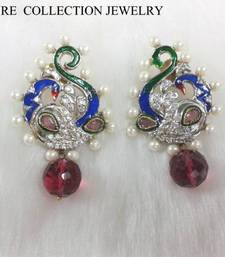 Buy RUBY and mayur pearl earring by signature in 18k gold plating Earring online