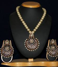 Buy BEAUTIFUL SHELL PEARLS NECKLACE SET WITH ANTIQUE LOCKET SET necklace-set online