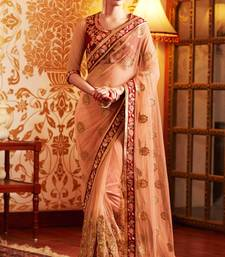 Buy Coral embroidered net saree with blouse net-saree online