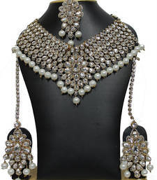 Buy Pearl strand necklace set with earrings and mangg tikka bridal-set online