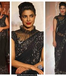 Buy Black net saree with complete silver zari and thread work  priyanka-chopra-saree online