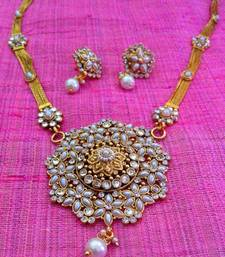 Buy Bold pearl flower with intricate stone work in a long necklace set g40rg Necklace online