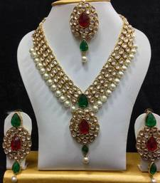 Buy Dazzling Kundan Set in Red and Green with Pearls necklace-set online