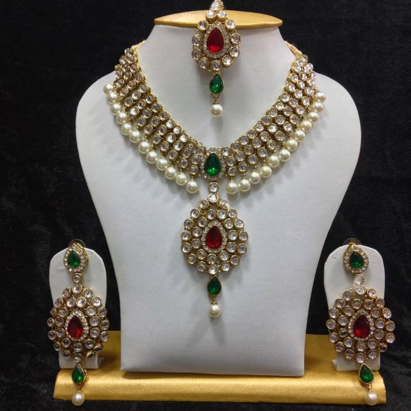 Buy Dazzling Kundan Set In Red And Green Stones And Pearls
