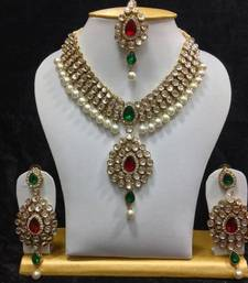 Buy Dazzling kundan set in red and green stones and pearls Necklace online