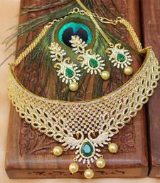 Buy GOLD PLATED DESIGNER PEACOCK  EMERALD  BRIDAL   NECKLACE WITH EARRINGS AND MAANG TIKKA necklace-set online