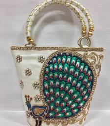 Buy Peacock Design Embroidery Handbag in Shiny White potli-bag online