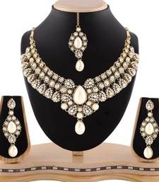 Buy Exclusive design pearl gold finishing white stone necklace set with maang tikka eid-jewellery online