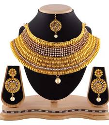 Buy Exotic pearl drop austrian stone gold finishing necklace set with maang tikka bridal-set online