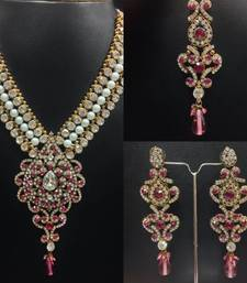 Buy Anarkali Kundan Jewelry Set with Pearls in Pink Necklace online