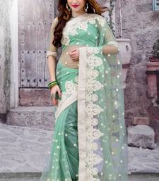 Buy Green embroidered net saree With Blouse designer-embroidered-saree online