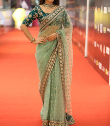 Buy Parrot green embroidered net saree with blouse net-saree online