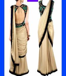 saree fabric-gold coating,blouse-dhupiyian,zari,seuence,thread work,golden colour