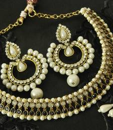 Buy Black colour Necklace & Dangling Pearl Earrings party-jewellery online