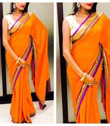 Buy Orange Crepe Saree with purple patti along with Leaf lace all over the saree with Gold jamwar blouse 80cm Unstitched crepe-saree online