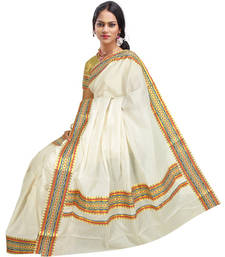 Buy cream colour sarees customised with brocade multi check lace work border. south-indian-saree online