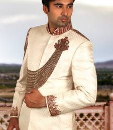 Buy cream brocade embroidered sherwani sherwani online