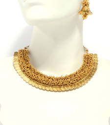 Buy ANTIQUE GOLDEN STONE STUDDED TRADITIONAL TEMPLE THEME NECKLACE SET punjabi-jewellery online
