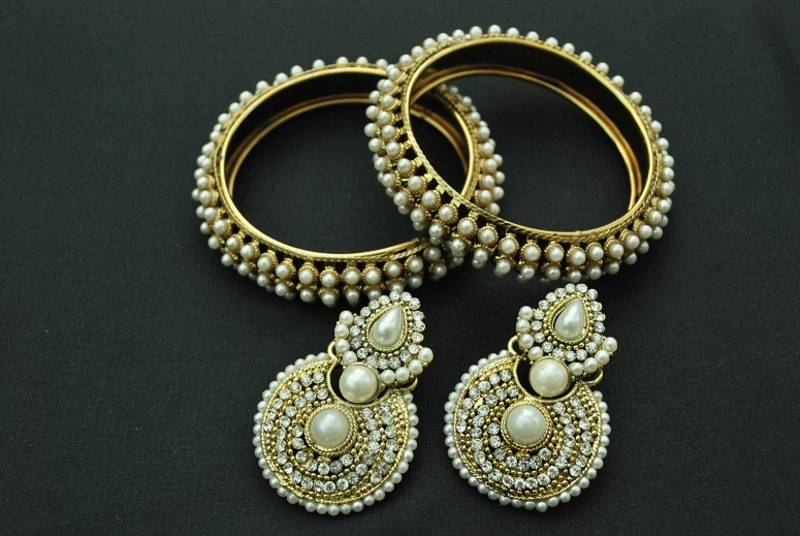 Buy exquisite stone studded earrings with a pearl trim and for Exquisite stone