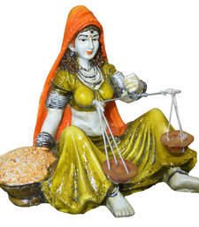 Buy Rajasthani lady with Taraju sculpture online