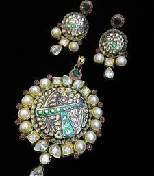 Buy maroon tanjore art kundan ruby pearl emerald fusion set Pendant online