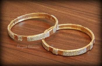 2.8, Bollywood style designer zircon stud golden plated bangles(set of 2)
