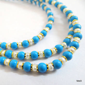 Three strand turquoise and pearl necklace