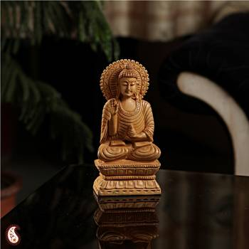 Uniquely carved Buddha on wood