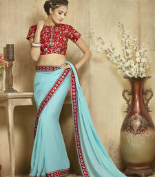 Buy turquoise embroidered viscose saree With Blouse viscose-saree online