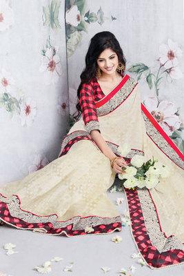 An Attractive Cream Art Silk Saree with Patch-patti work