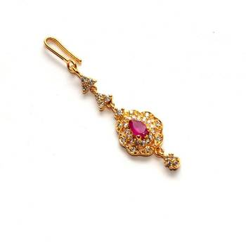 Anvi's cz maang tikka cenetered with ruby