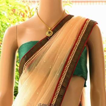 Elegant net saree with crystal and zardosi
