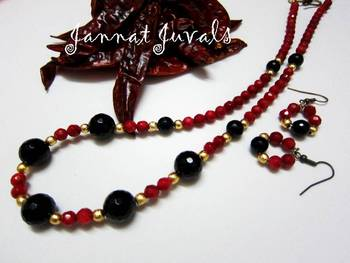 Red coral chillies with black onyx