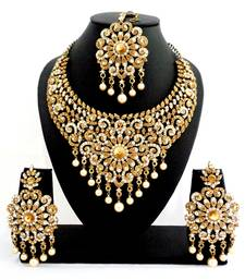 Buy Designer golden white stone bridal necklace set with maang tikka necklace-set online