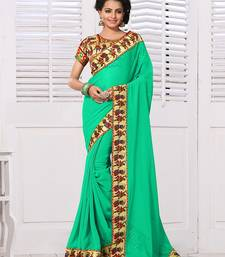 Buy Green embroidered georgette saree with blouse below-1500 online