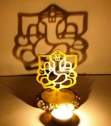 Buy Exclusive shadow diya tealight candle holder of removable ganesha idol diya online