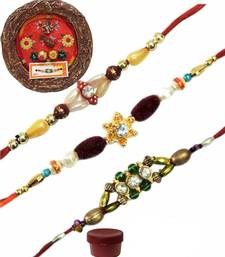 Buy Remarkable of three beautiful rakhis with designer thali bhaiya-bhabhi-rakhi online