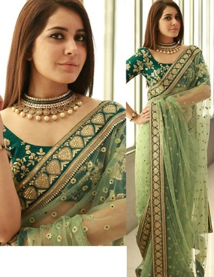Light green embroidered net saree with blouse