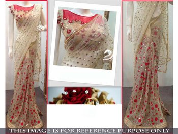Cream embroidered net saree with blouse