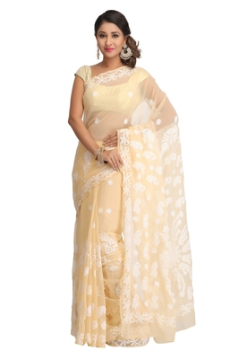Fawn embroidered faux georgette saree with blouse