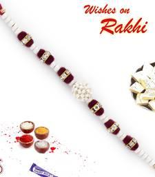 Buy Transparent Crystal Beads  and  White Pearl Rakhi pearl-rakhi-design online