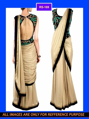 golden fabric saree with heavy blouse