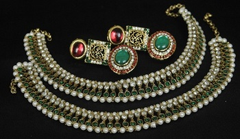 Gold Plated Handcrafted Maroon, Green Earrings & Green colour Anklets
