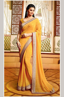 Daisy Shah Sunflower Tone Georgette Saree Containing Lace border with Art Silk Blouse Piece
