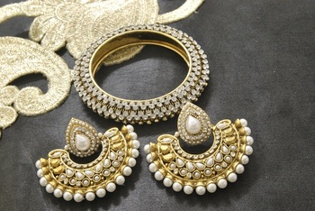 New Ram Leela Pearl Earrings with Gold Plated Kada studded with Stones